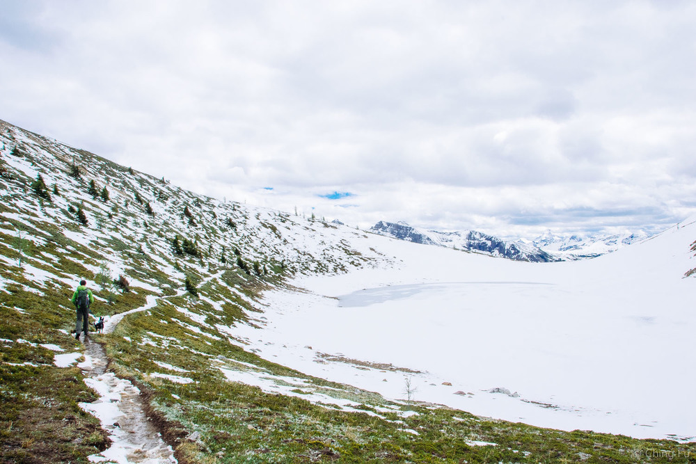 Hiking up to Harvey Pass by the frozen lake.