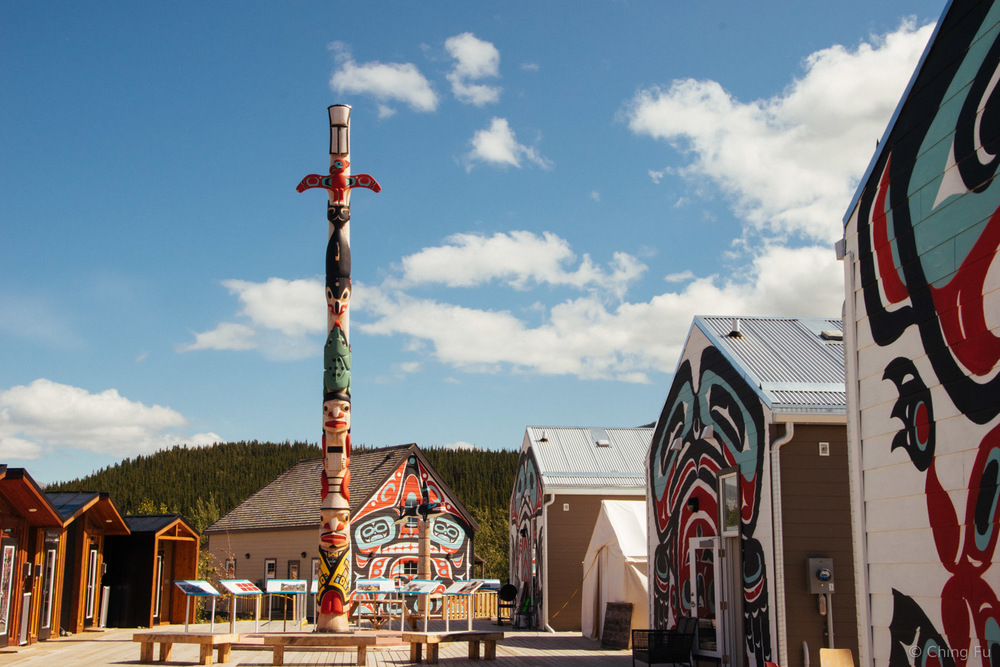Carcross Commons, the retail center of town where the visitor center is also located. The murals on the building represent the Six Clans associated with the Carcross Tagish First Nation.