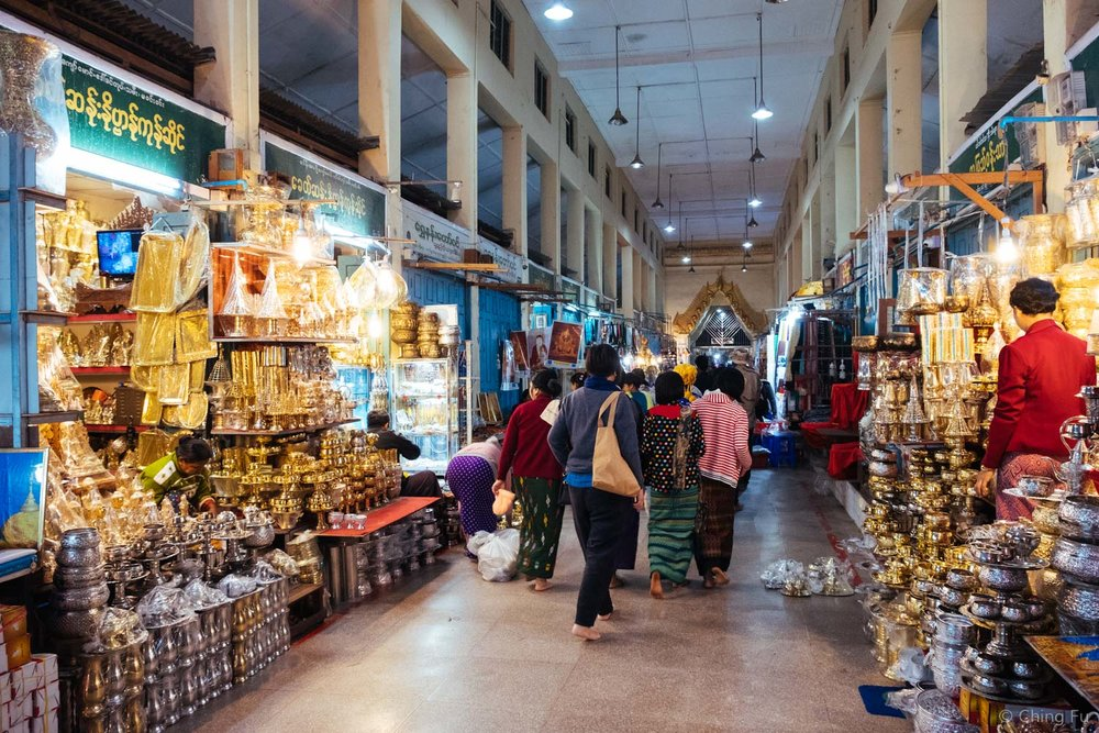 Vendors were opening up their shops as we walked out. Although people selling flowers and food, which are bought and offered to Buddha, were outside the pagoda as visitors entered around 4:30 AM.