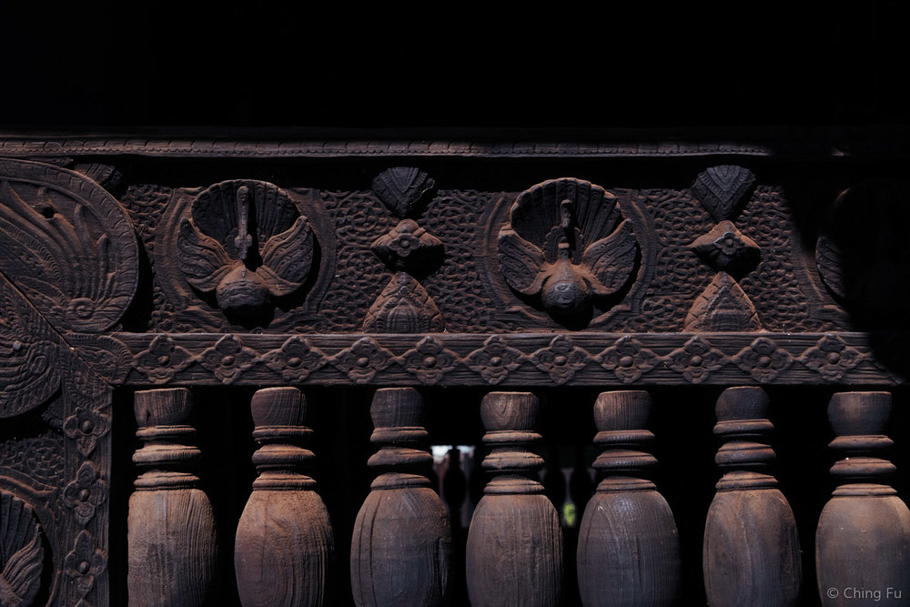 Carving on the teak wood of Bagaya Monastery
