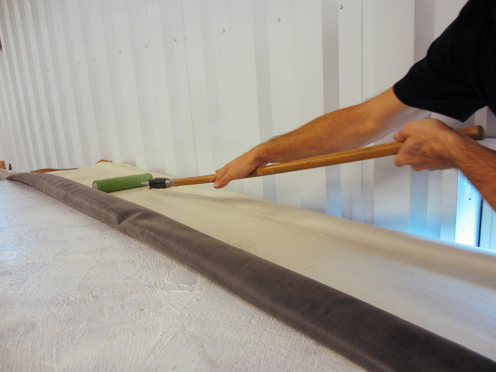 The rubber roof membrane was then rolled out and we used a paint roller to smooth it.