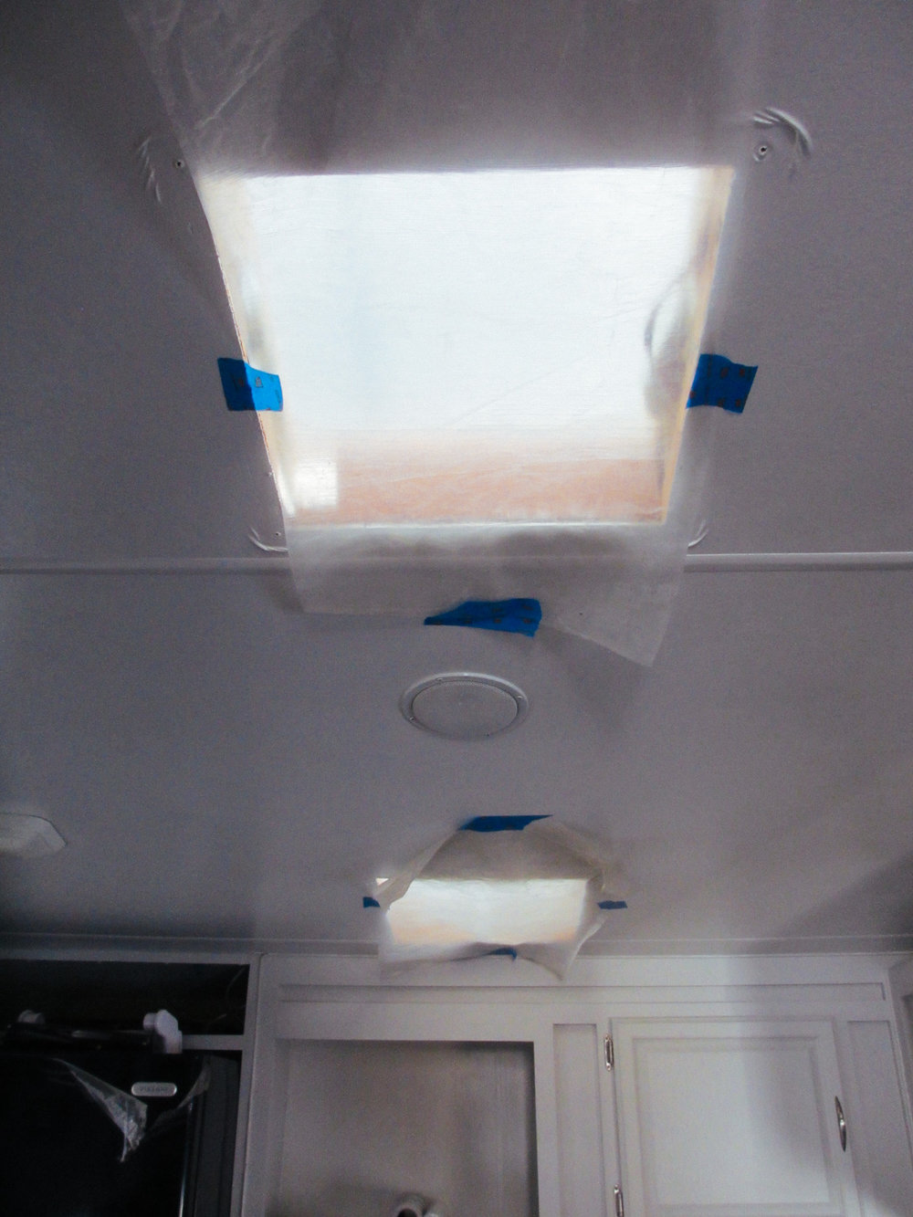 We covered the inside of the vent holes with plastic to prevent roof adhesive dripping into the rig.