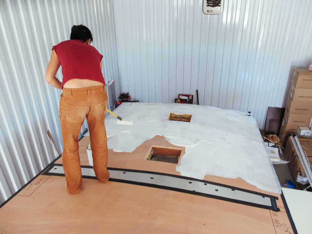 The same process we used to put the rubber roof membrane on the slide was used on the rest of the RV's roof.