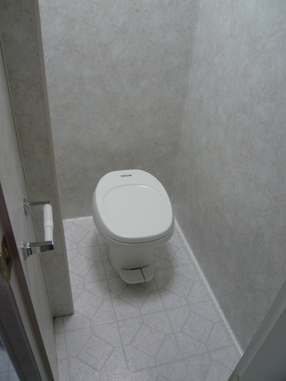 This was how the toilet room originally looked. It sits to the left of the shower, separated by a wall.