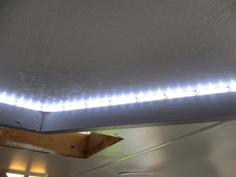 We also installed LED strip lights behind the valance so we wouldn't have to shower in the dark.