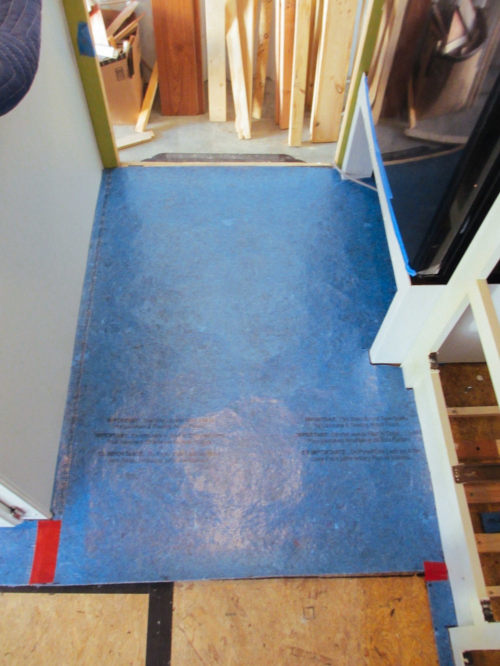 Underlayment was placed on top of the subfloor in preparation for the laminate floor.