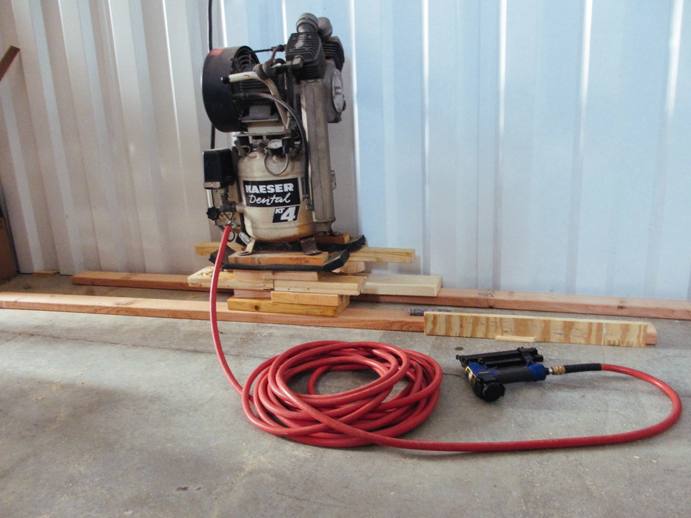 We borrowed an air compressor nail gun to nail the floor trim pieces.