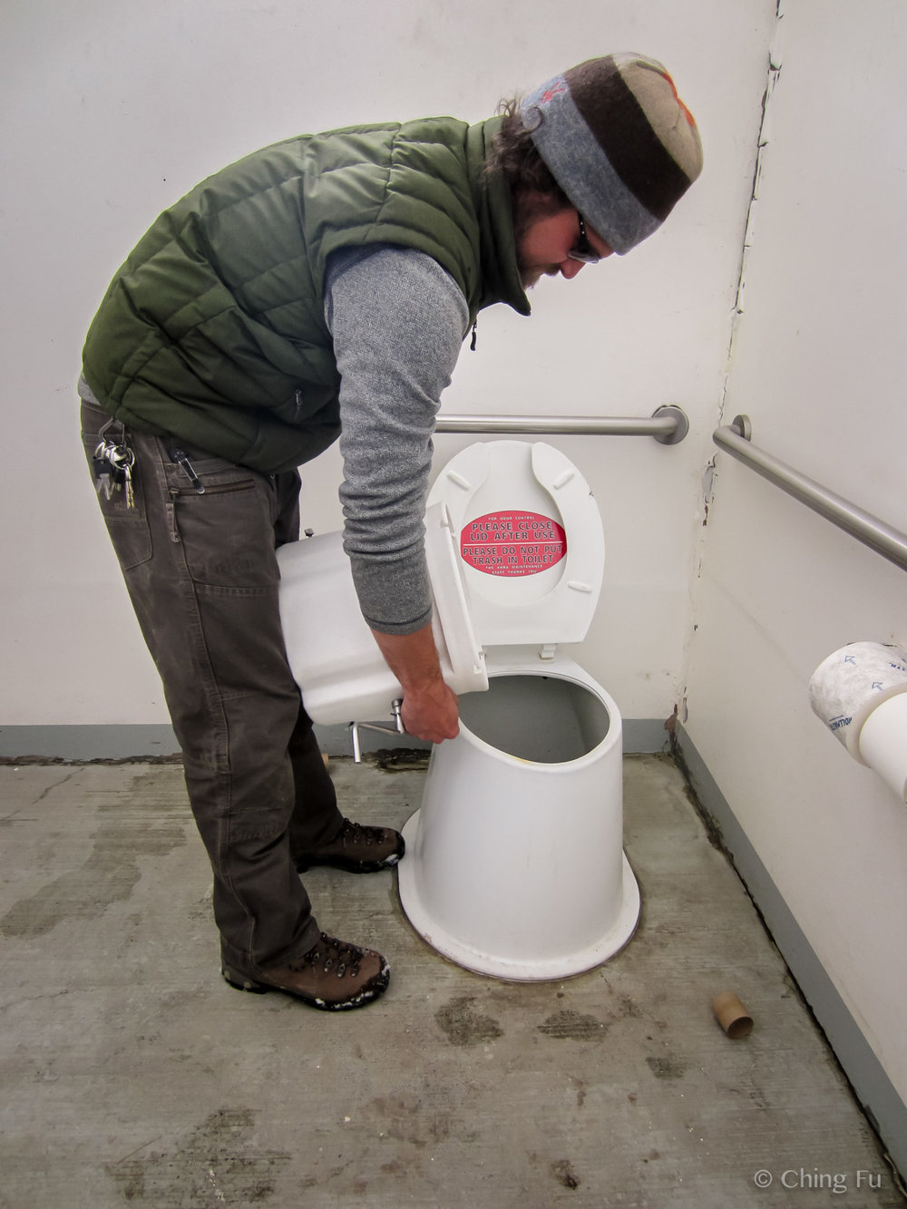 Emptying out our composting toilet at a trailhead pit toilet.