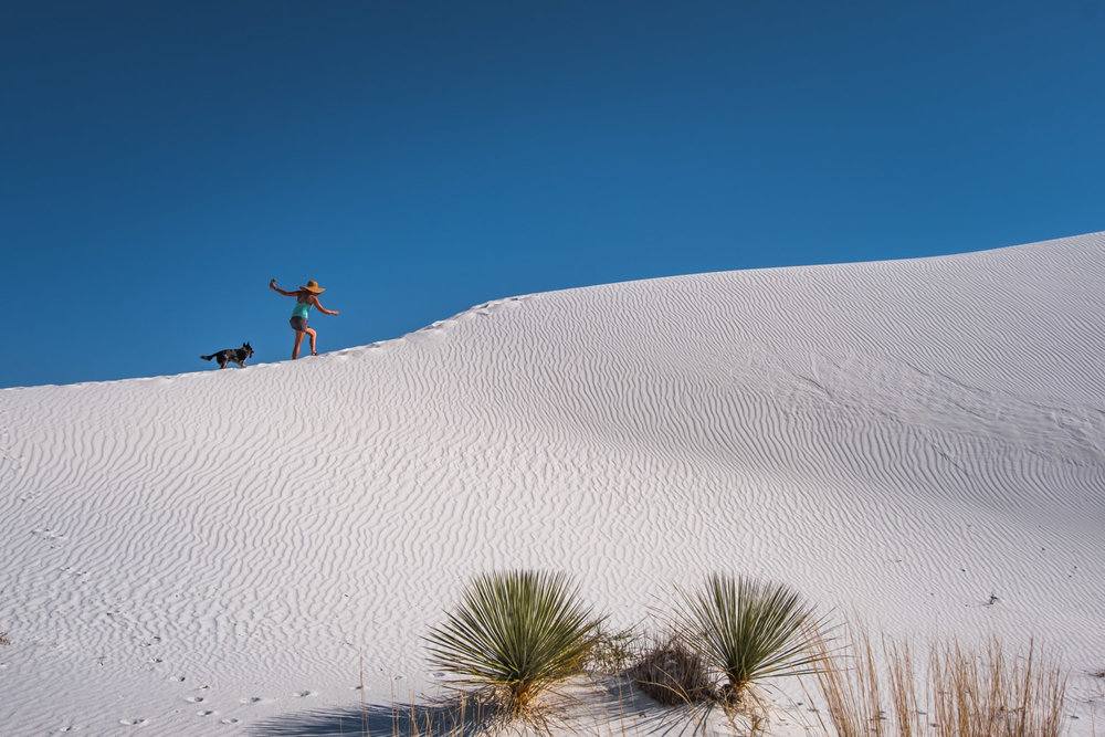 Hiking up dunes at White Sands National Monument.