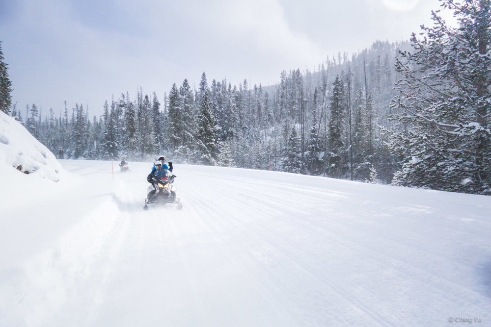 Bill and Dolly behind us on snowmobiles in Yellowstone National Park.