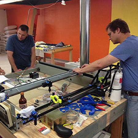 Volunteers building the makespace