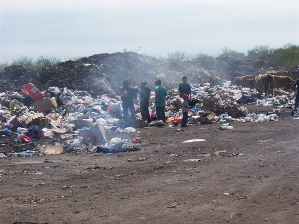 Men, woman, and children were digging through piles of burning trash, releasing toxic chemicals into the air. There were also cows, crows, and dogs walking through the trash looking for food.