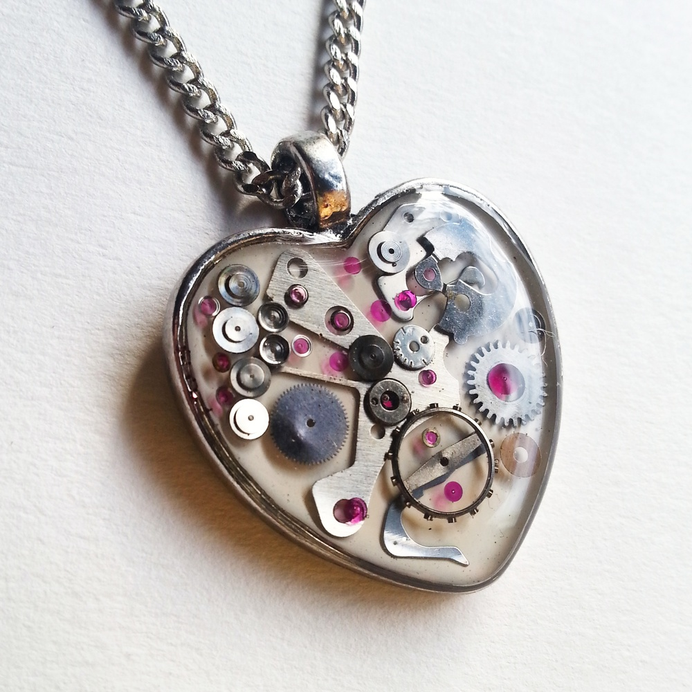 This snow white Mechanical Heart contains lots of pink jewels!