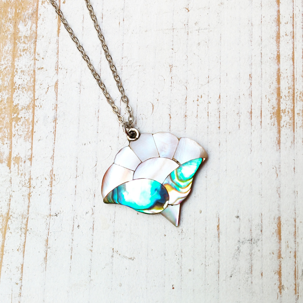 Also available at Arts Market, this beautiful abalone flower/sunrise pendant