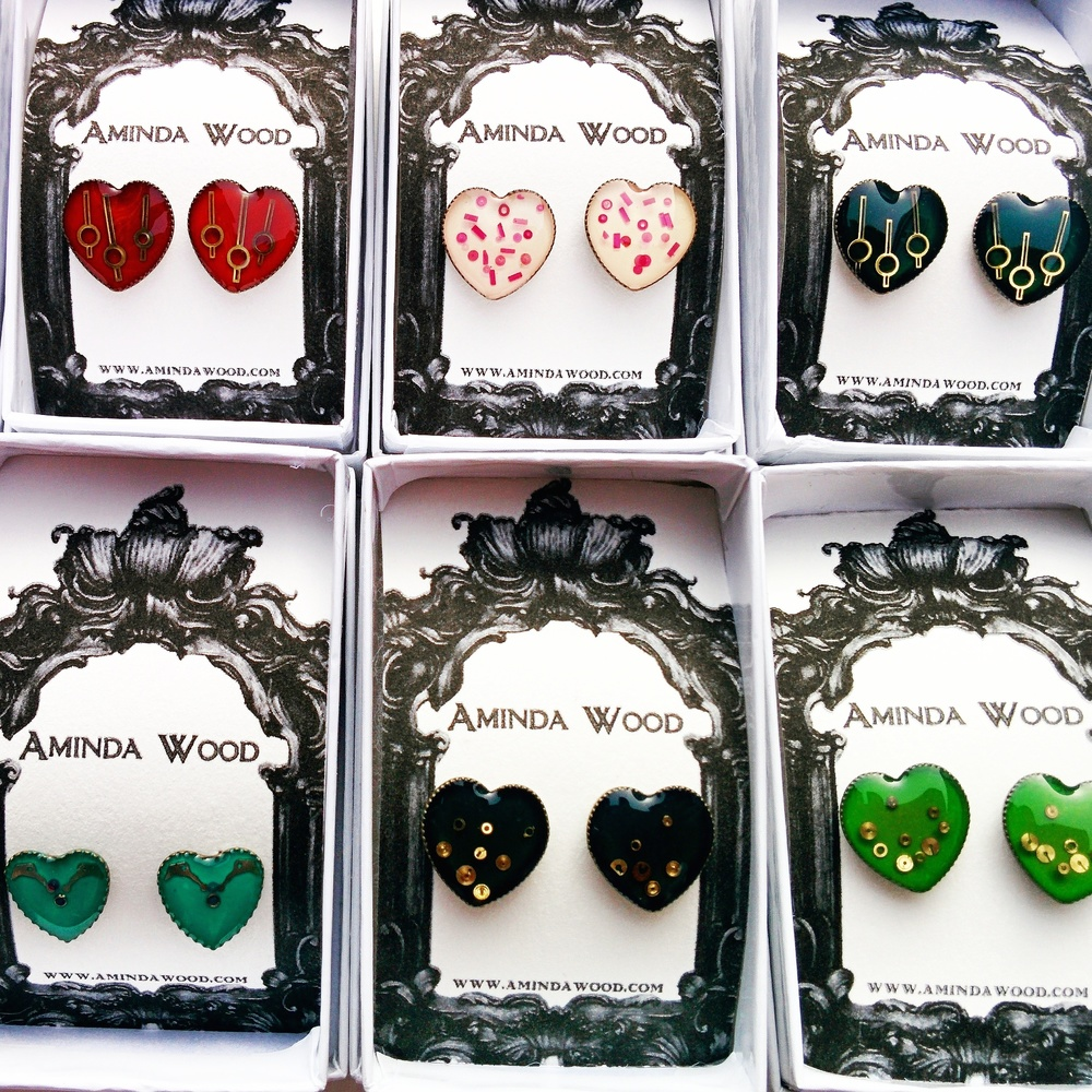 A restock of my popular Mechanical Heart mini stud earrings in a rainbow of colours!