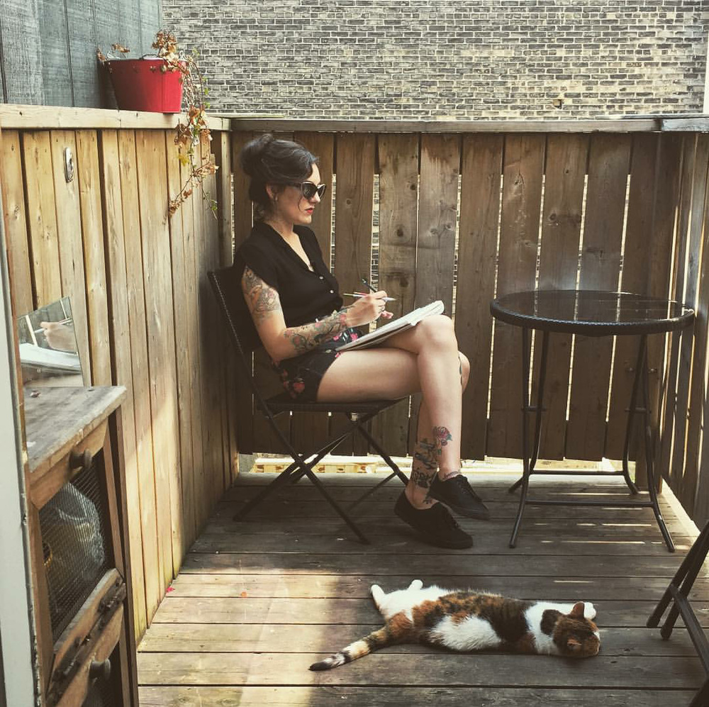 Drawing on the porch while Seven keeps me company photo by Sydney Urbanek