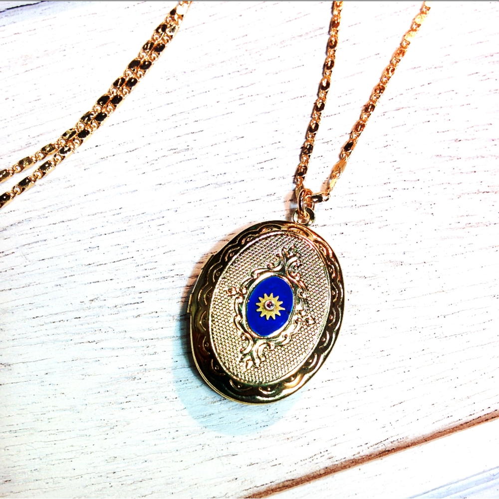 vintage locket with minimal cog detail