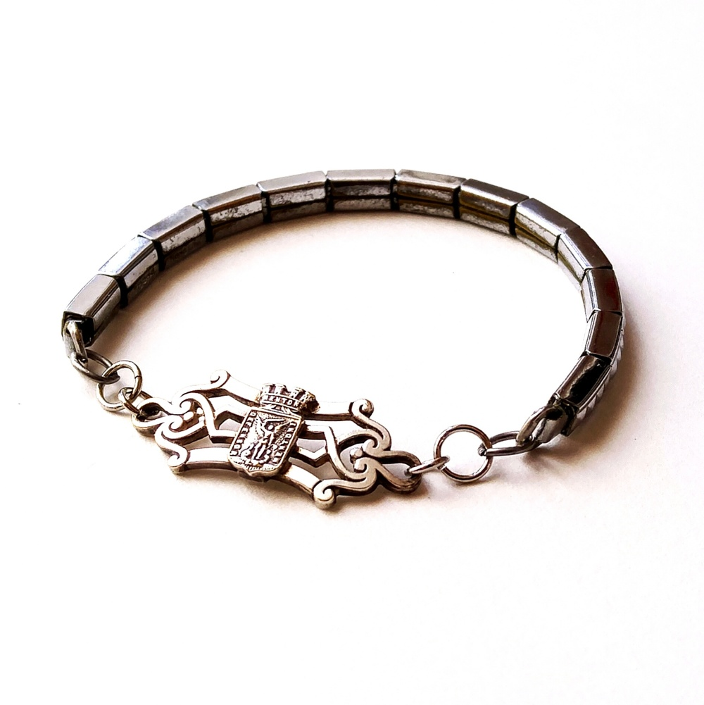 This beautiful sterling piece has been made into a bracelet with a watch band, find it at CHOSEN Vintage.