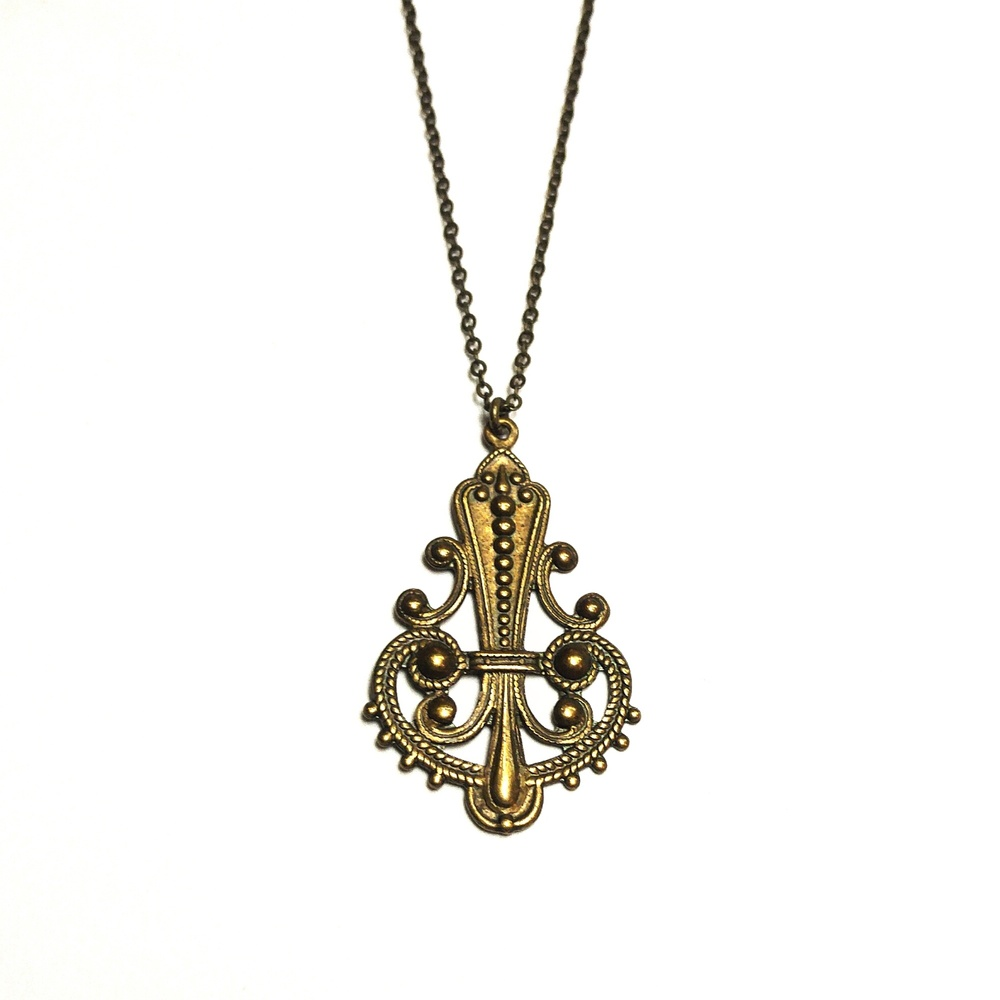 Detailed brass pendant