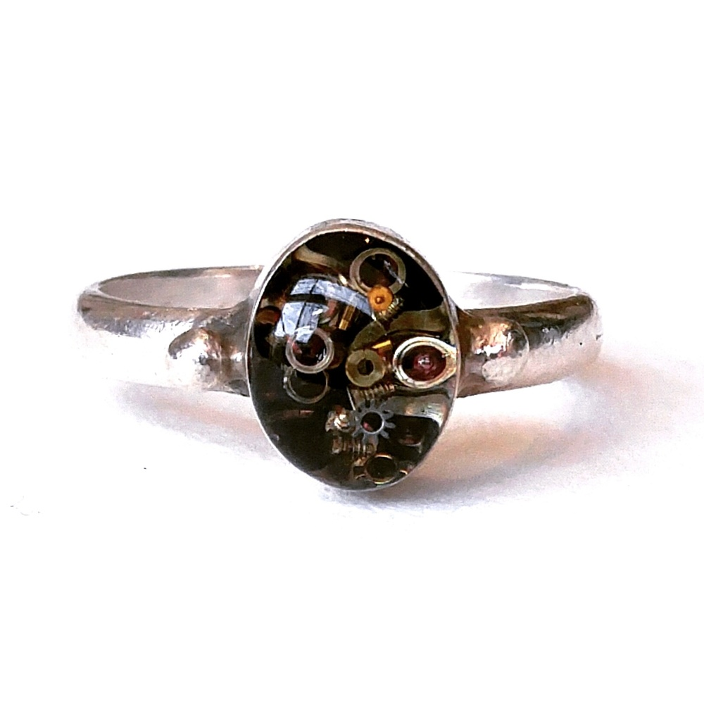 One of a kind Sterling Silver ring, made from vintage base. Deep hollowed cabochon setting inlaid with 5 sparkling layers of resin containing only the tiniest watch parts!