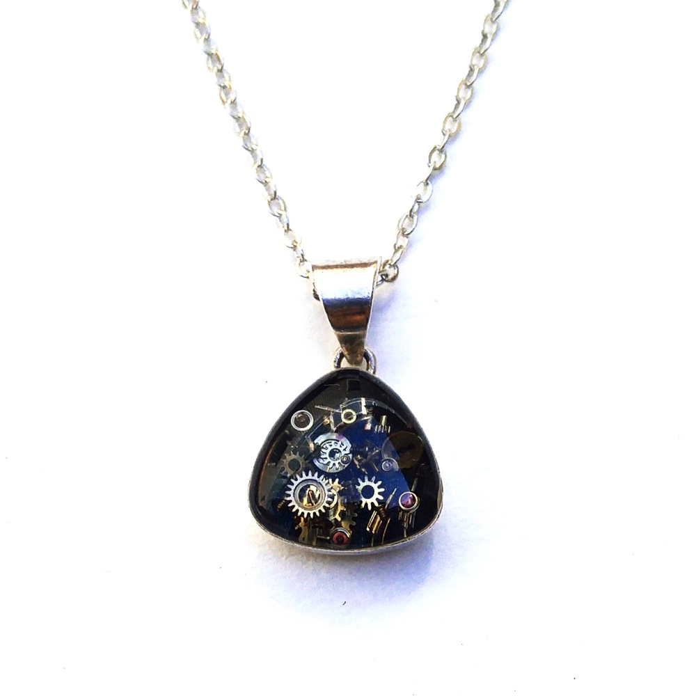 Sterling Silver pendant containing a hand panted sapphire blue base and five layers of beautiful, delicate tiny watch parts, set in separate layers of resin.