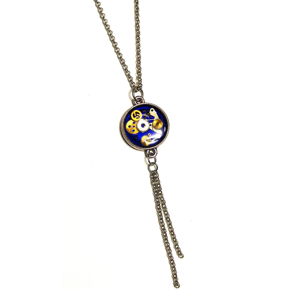 Long hanging watch part pendant with signature fringe, contains a unique watch part composition, highlighted by the hand painted royal blue base,