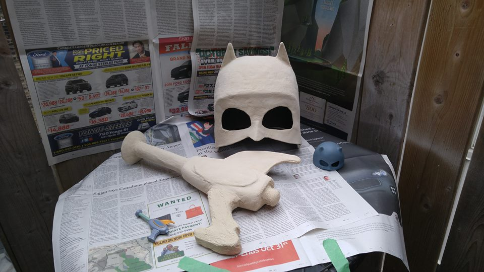 After coating the paper mache in wood filler, the Ray-Gun and Teenage Bondage Mask are ready to be sanded and painted.