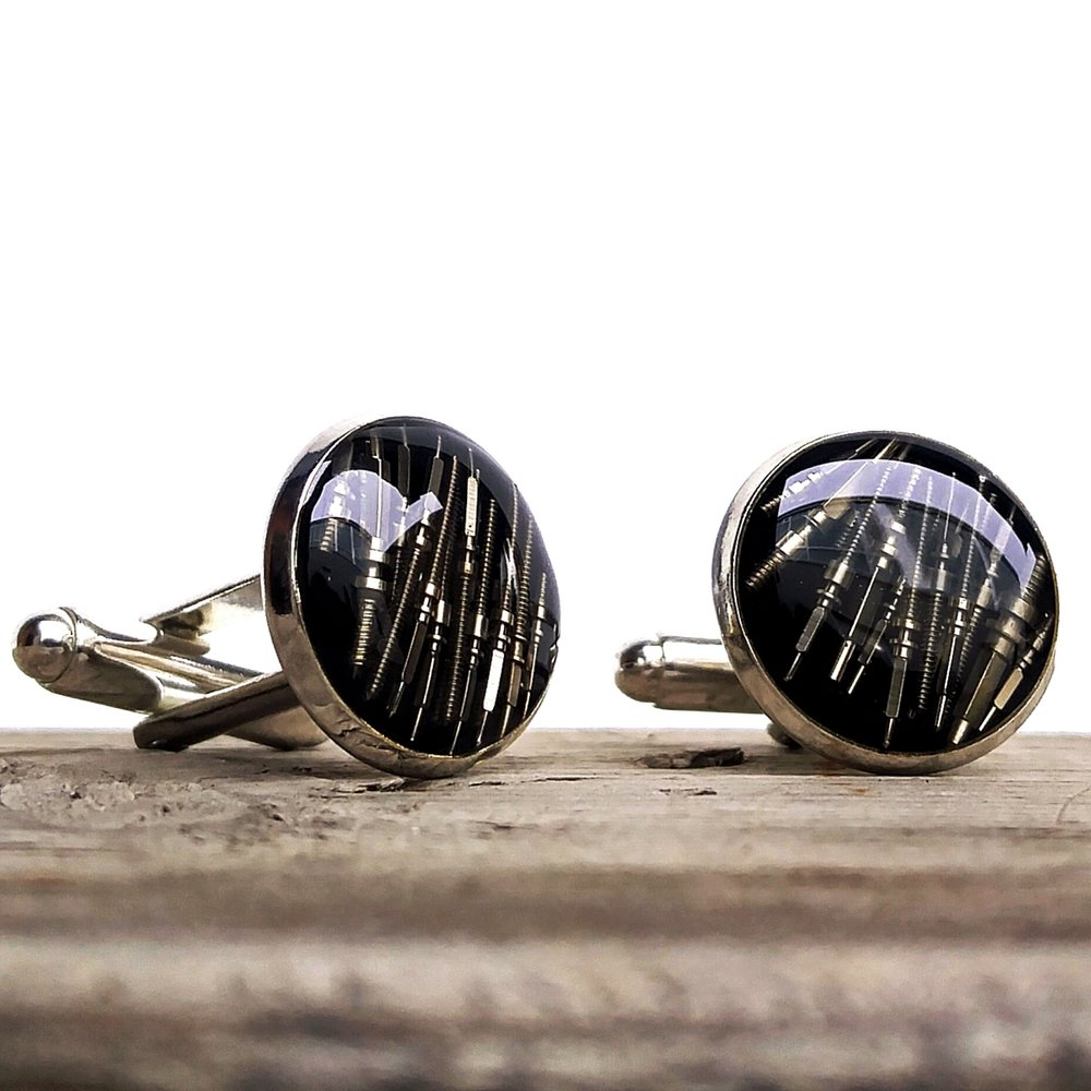 These black based cufflinks contain multiple layers of winding posts & tension bars!