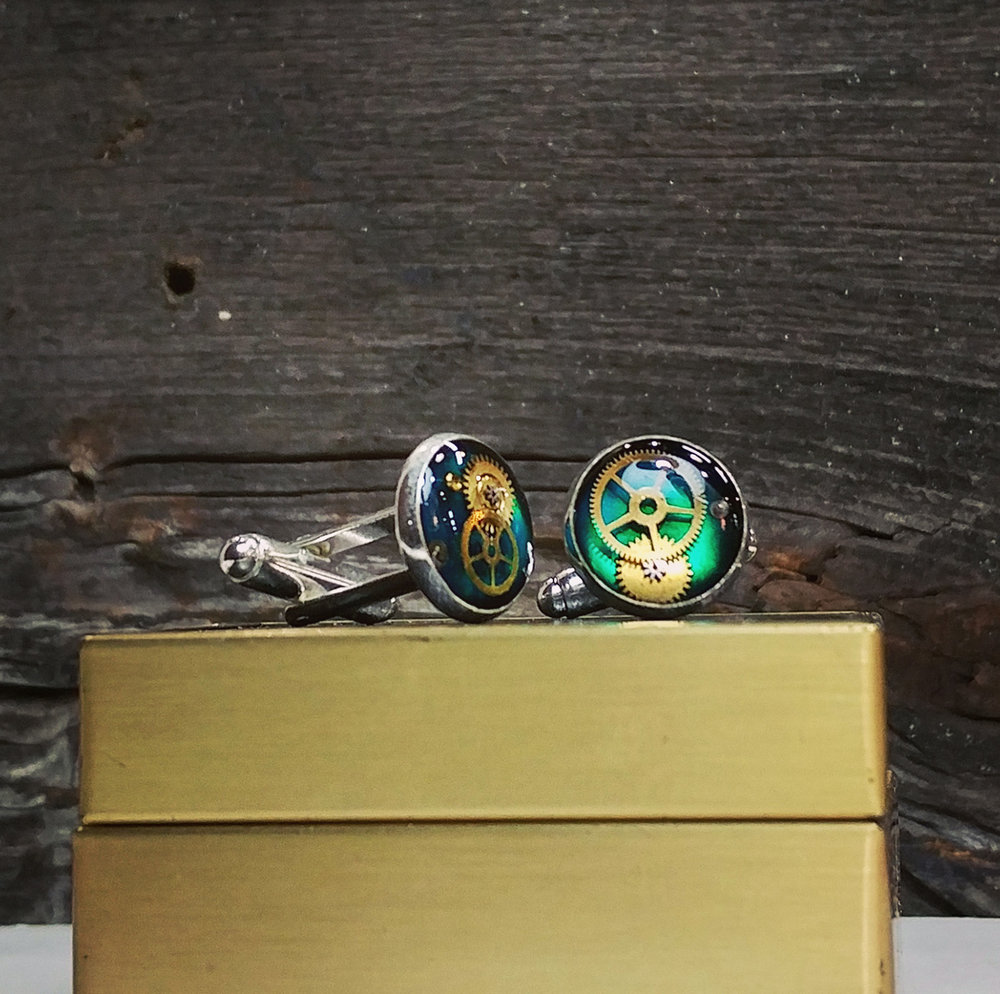 Emerald green cufflinks with watch parts set in resin