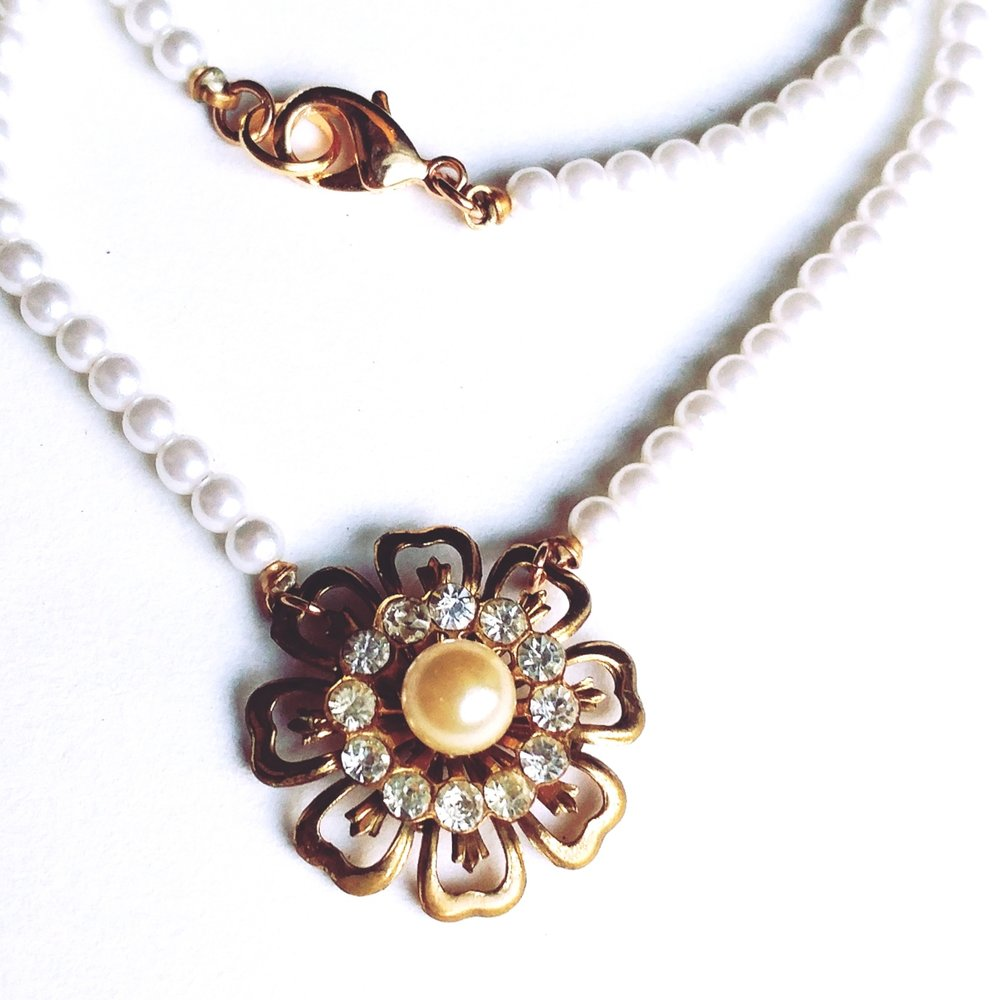 pearl necklace with vintage pendant created from a former brooch