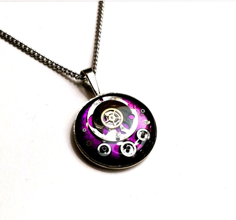 Rich purple resin watch parts pendant, available at the Leslieville Arts Market