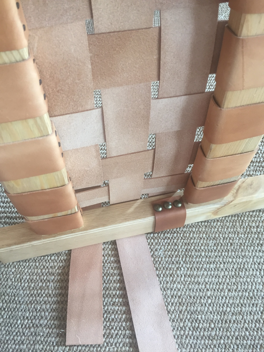 Use brass tacks to nail final three strips in place