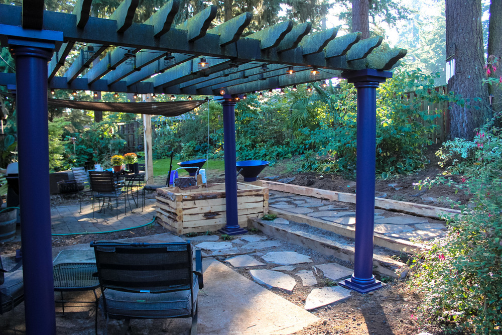 Here is our backyard project.  We're putting a roof on the pergola tomorrow!