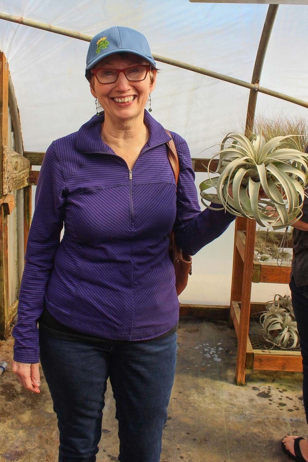 Patricia rocking her new Little Prince Nursery cap and Tillandsia xerographica!