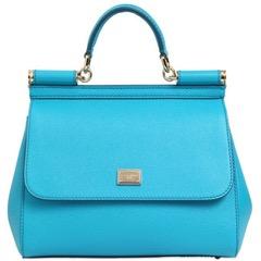 blue round handle purse.jpg
