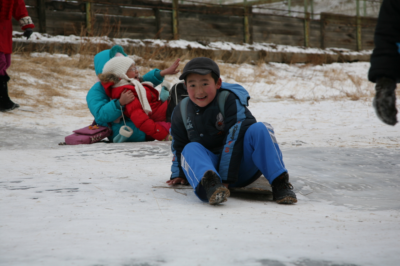 it's amazing how much joy kids can get from an ice-covered hill.  for hours.