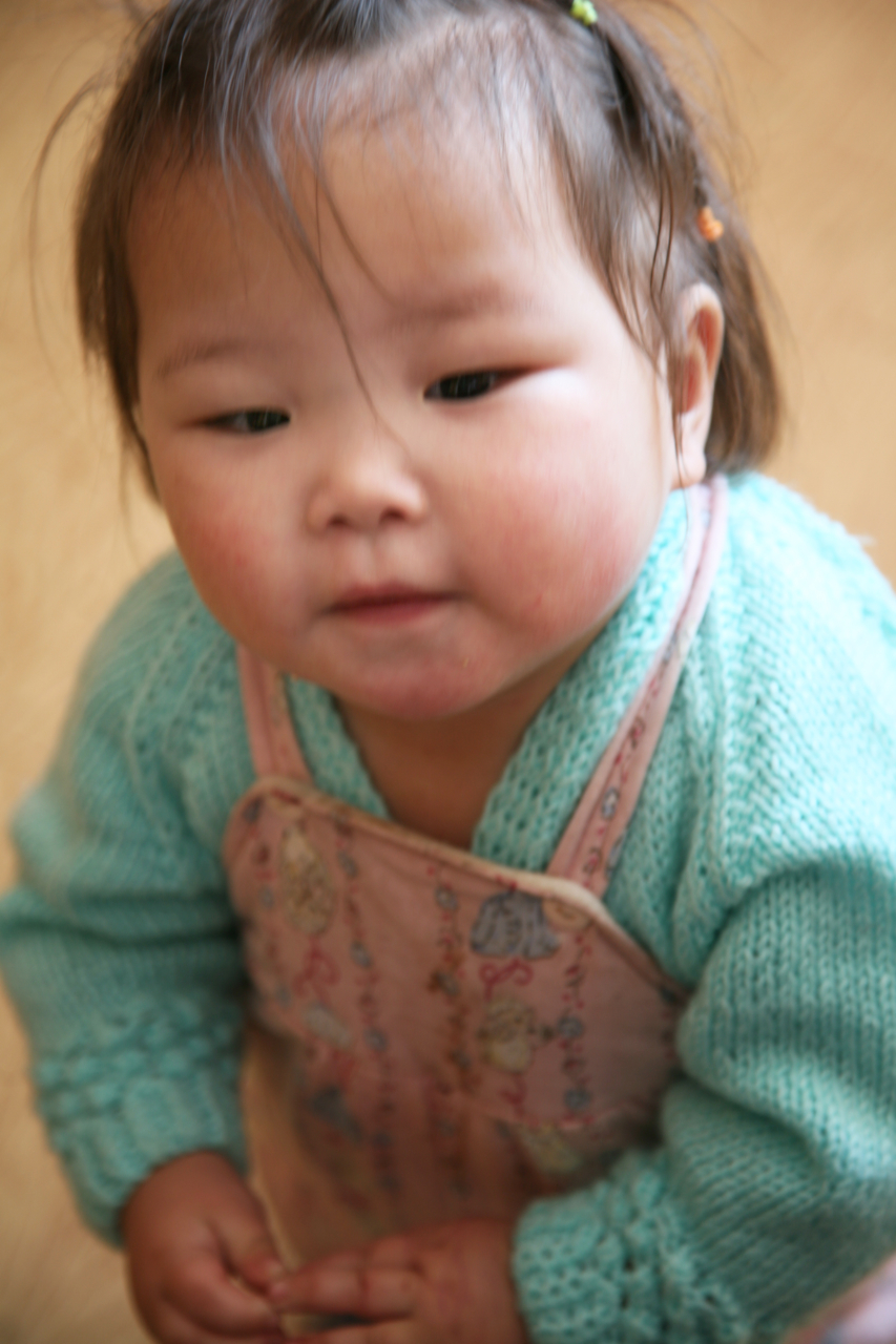 i met this adorable child during tsagaan sar, a national holiday here, and she was very intrigued by my camera.