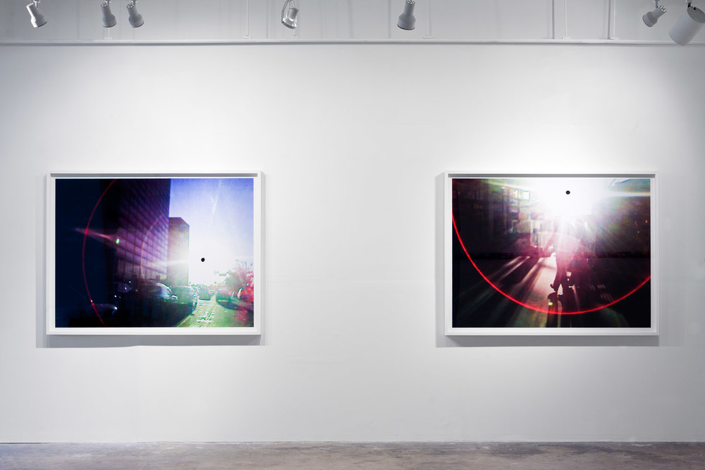 'Black Sun 0006' (left), 'Black Sun 0009' (right), 48 x 64 inch, c-prints on diasec in wood frames, Black Sun Project, at Bas Fisher Invitational, 2008.