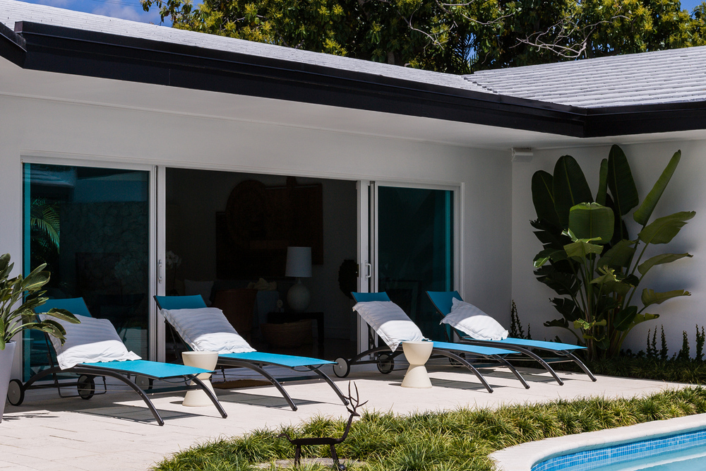 Pool lounge chairs looking into the livingroom, Miami Shores Home