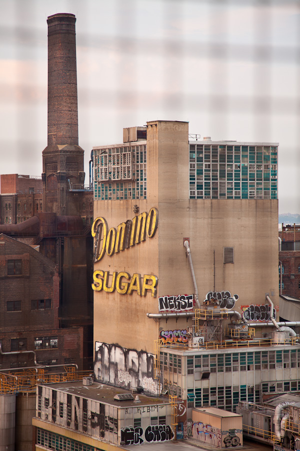 The view from on the Williamsburg Bridge of rotting Domino Sugar factory. ©2010 harlan erskine