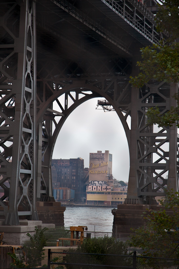 Domino Sugar Factory from the Manhattan side, framed by the arches of the Williamsburg Bridge. ©2010 harlan erskine