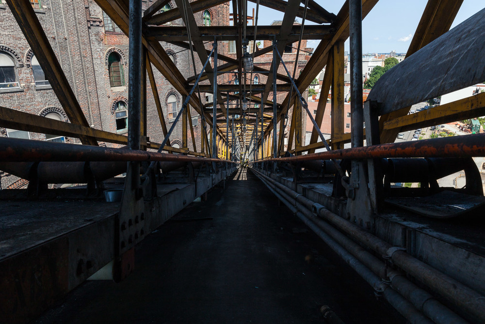 Looking North down Conveyor Bridge toward Refinery Building, Bin Structure, Domino Sugar Factory