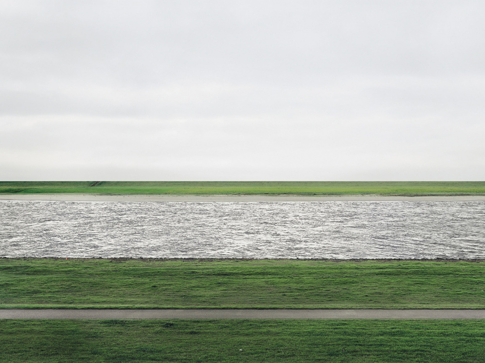 Andreas Gursky, Rhine II, C-print mounted to acrylic glass, 73 × 143 in. 1999.