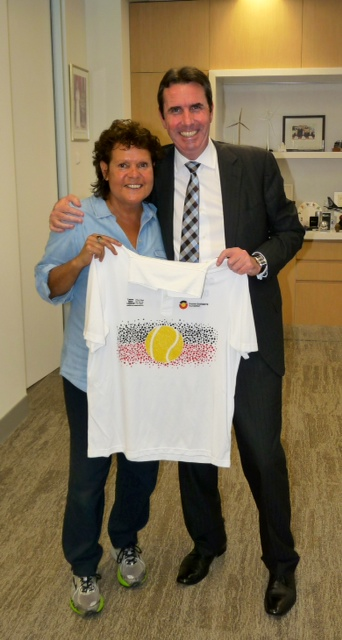 Evonne presenting Mr Peter Collier the Western Australian Minister for Aboriginal Affairs with an Evonne Goolagong Foundation Shirt.