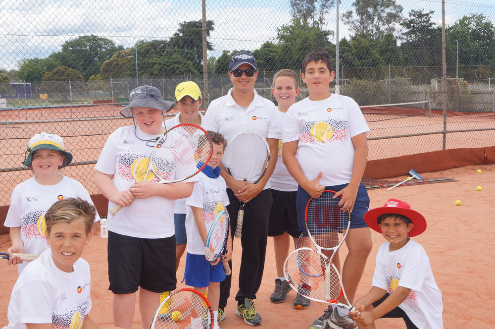 Evonne Goolagong Foundation Head Coach Anzac Leidig with some happy players including local Toby Radford (yellow hat)  who has been selected for the Goolagong National Development Camp 2015. Congratulations to all on giving of their best.