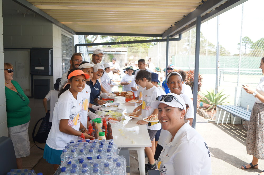 Healthy lunchtime in Coffs – Goolagong National Development Camp's Laquisa and Asia Khan join Hayley, Evonne, Jarred and Adam in serving the famished masses
