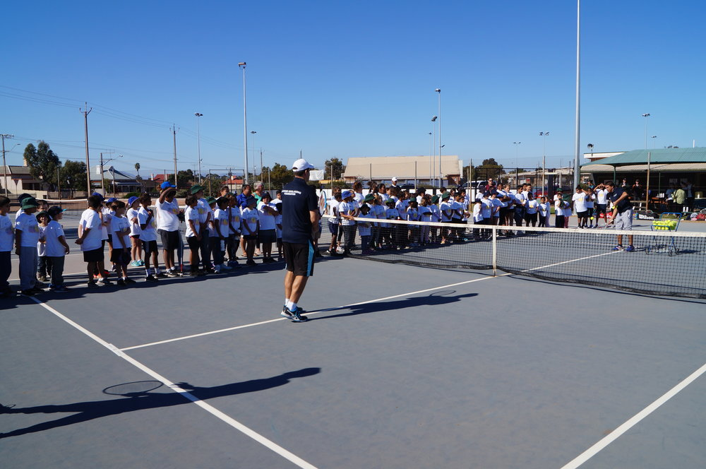 Anzac and Adam introduce tennis skills to the Port Augusta kids