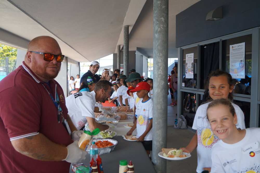 Wuchopperen Health Service help us serve lunch to the happy, hungry kids""