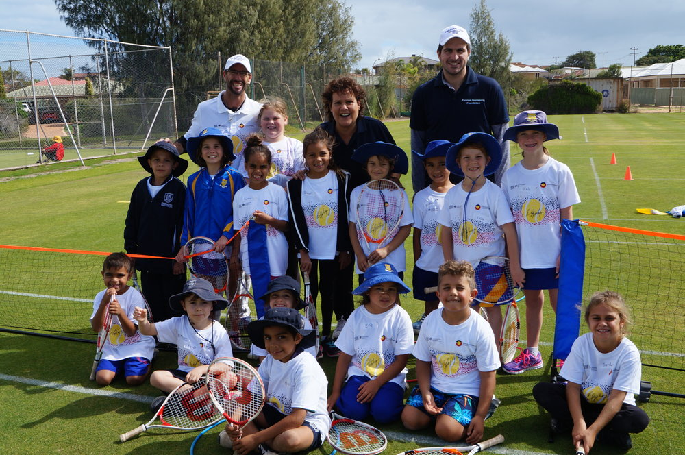 Jarred, Evonne and Adam with some of the 102 youngsters who had fun at Come & Try Day in Geraldton