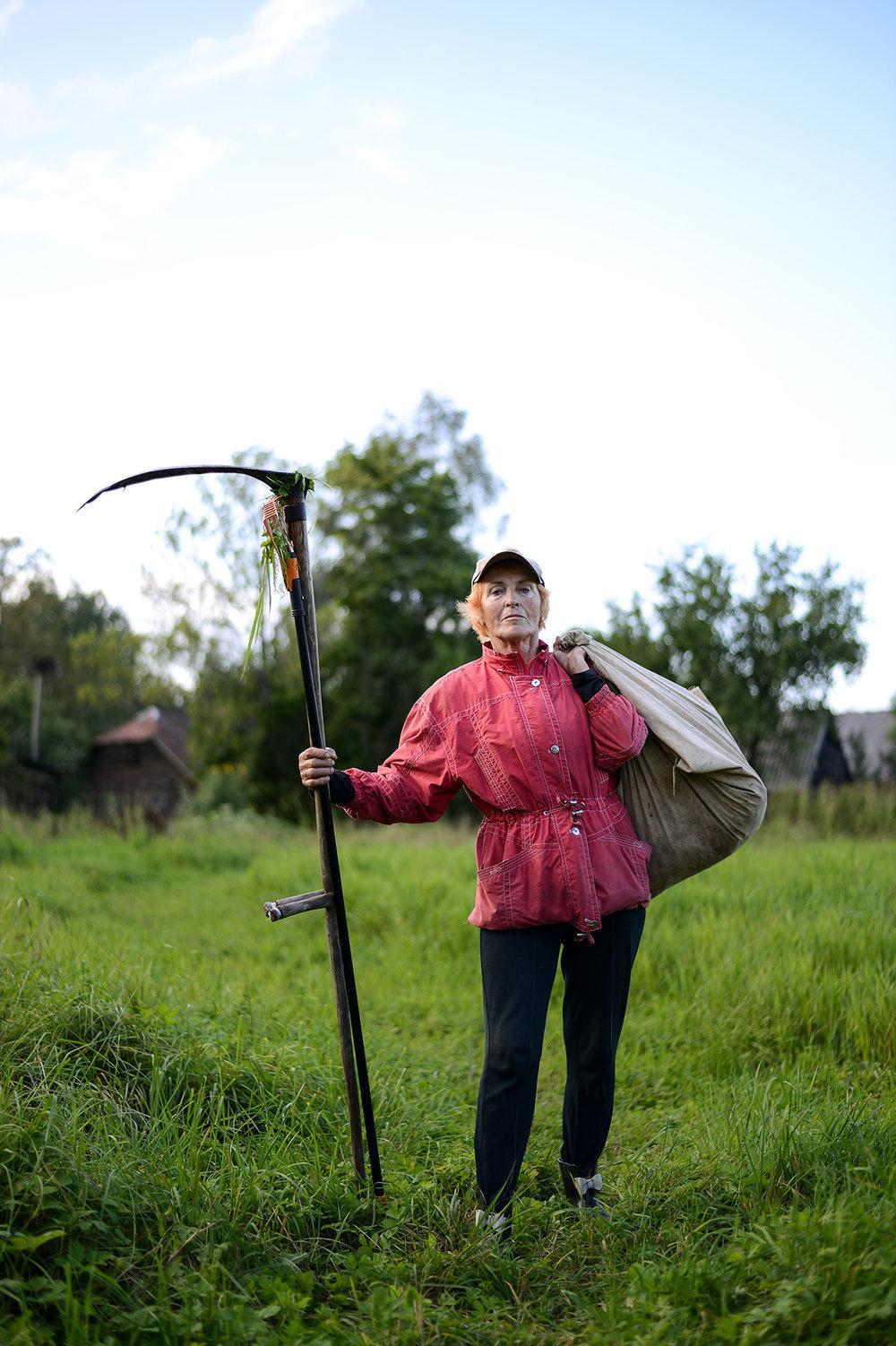 Grandma Cutting Hay